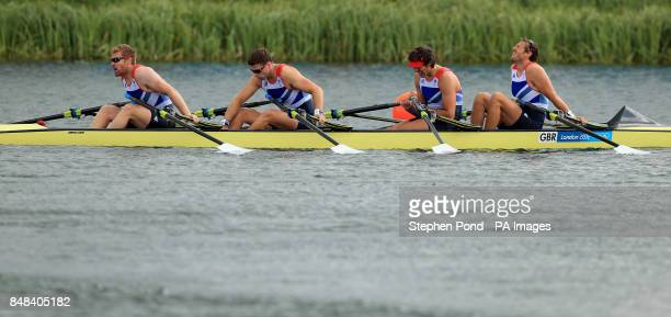 Great Britain's men's quadruple scull crew of Matt Wells Tom Solesbury Charles Cousins and Stephen Rowbotham react after failing to medal in the...