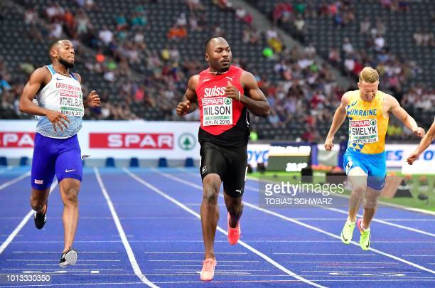 Great Britain's Nethaneel MitchellBlake Switzerland's Alex Wilson and Ukraine's Serhiy Smelyk compete in the men's 200m semifinal race during the...