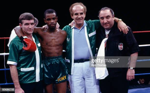 Great Britain's new European Flyweight Champion Duke McKenzie pictured with his management team after knocking out Agapito Gomez at the Wembley Arena...