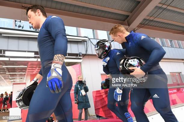 Great Britain's Nick Gleeson Great Britain's Brad Hall and a team mate walk off the track after the 4man bobsleigh heat 4 final run during the...