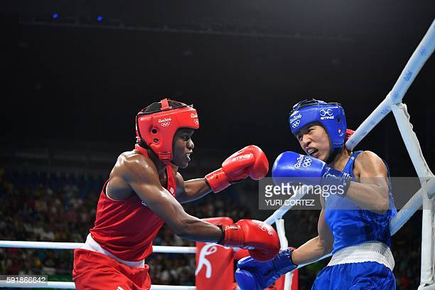 Great Britain's Nicola Adams fights China's Ren Cancan during the Women's Fly Semifinal 1 match at the Rio 2016 Olympic Games at the Riocentro...