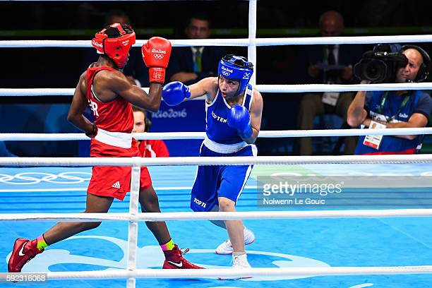 Great Britain's Nicola Adams in action against France's Sarah Ourahmoune during a Women's Fly final bout on Day 15 of the 2016 Rio Olympic Games at...