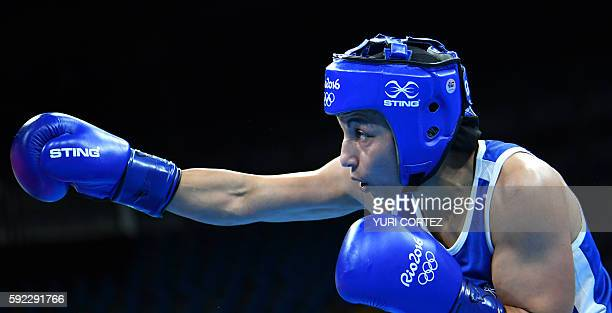 Great Britain's Nicola Adams is seen as she fights France's Sarah Ourahmoune during the Women's Fly Final Bout at the Rio 2016 Olympic Games at the...