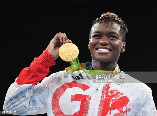 Great Britain's Nicola Adams poses on the podium with a gold medal during the Rio 2016 Olympic Games at the Riocentro - Pavilion 6 in Rio de Janeiro...