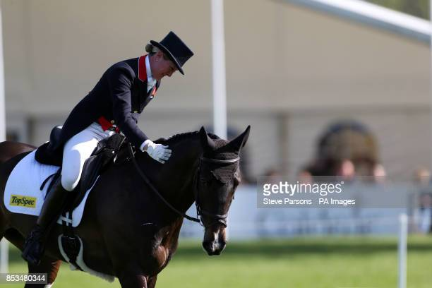 Great Britain's Nicola Wilson riding Beltane Green bursts into tears of joy after competing in the dressage phase during day three of the Mitsubishi...
