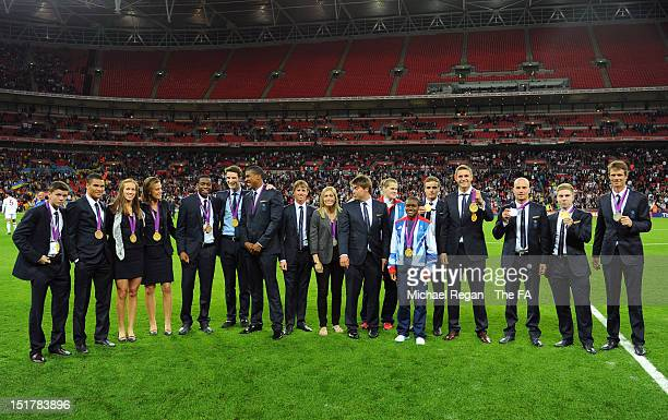 Great Britain's Olympic medallists are pictured at half time during the FIFA 2014 World Cup qualifier group H match between England and Ukraine at...