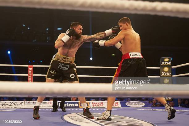 Great Britain's Paul Smith and WBA supermiddleweight World Champion Tyron Zeuge from Germany fight in Wetzlar Germany 17 June 2017 Zeuge defeated the...