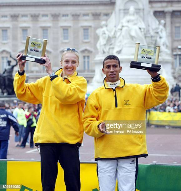 Great Britain's Paula Radcliffe and USA's Khalid Khannouchi hold up their winners plaques for the 2002 Flora London Marathon Paula Radcliffe produced...