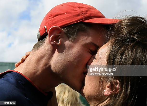 Great Britain's Peter Robert Russell Wilson kisses his girlfriend Adelle after winning the gold medal in the men's shooting double trap final at the...
