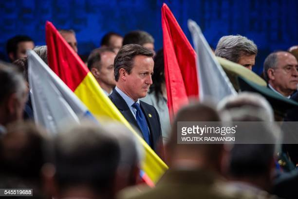 Great Britain's Prime Minister David Cameron stands during one minute of silence in memory of the killed soldiers during the meeting of heads of...