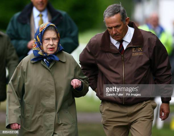 Great Britain's Queen Elizabeth II arrives with Terry Pendry stud groom at the Royal Mews to watch the Ladies SideSaddle in the Copper Horse Arena...
