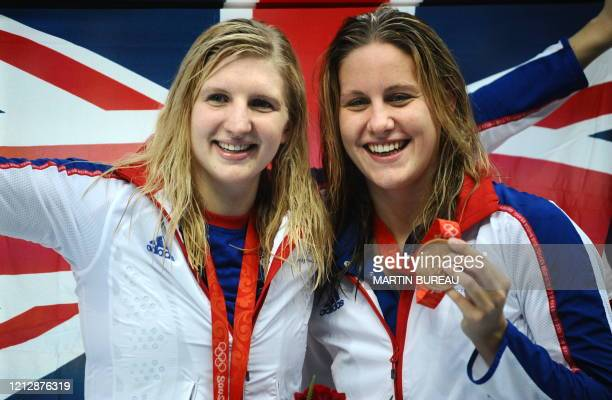 Great Britain's Rebecca Adlington celebrates with compatriot Joanne Jackson after the women's 400m freestyle swimming medal ceremony at the National...