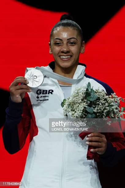 Great Britain's Rebecca Downie poses on the podium with her medal during the medal ceremony for the uneven bars event after the apparatus finals at...