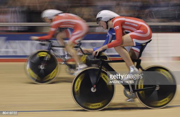 Great Britain's Rebecca Romero and Joanna Rowsell react as they cross the finish line and defeat Ukraine during the women's team pursuit finals in...