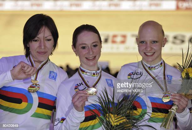 Great Britain's Rebecca Romero, Wendy Houvenaghel and Joanna Rowsell pose with their gold medal after defeating Ukraine in the women's team in the...
