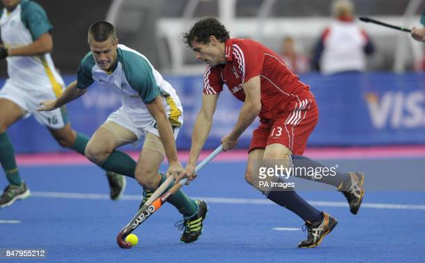 Great Britain's Rob Moore is challenged by Australia's Matt Gohdes during the Visa International Invitational Hockey Tournament at the Riverbank...