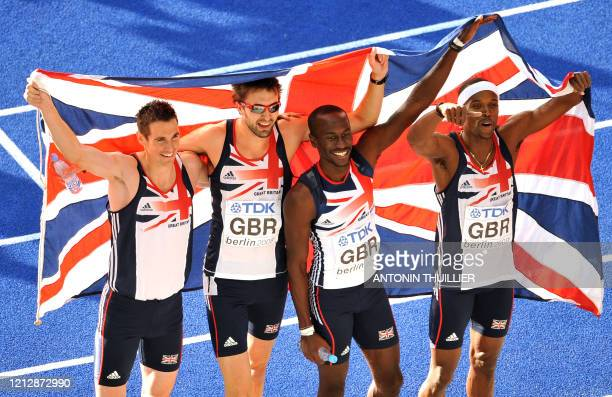 Great Britain's Robert Tobin Martyn Roone Michael Bingham and Conrad Williams celebrate their second place in the men's 4x400m relay final of the...