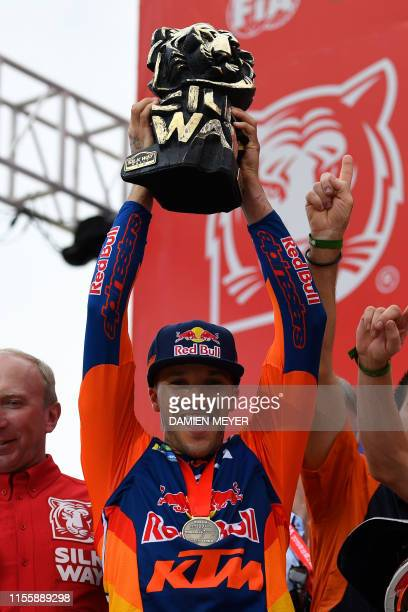 Great Britain's Sam Sunderland celebrates after winning the Silk Way Rally 2019 in Dunhuang on July 16, 2019.