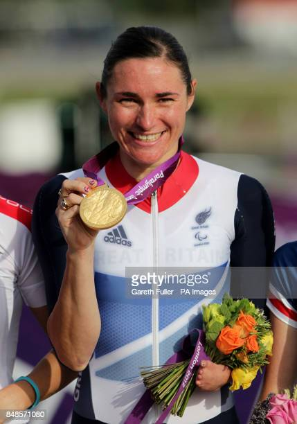 Great Britain's Sarah Storey celebrates on the podium with her gold medal after winning the Women's Individual C 4-5 Road Race at Brands Hatch in...