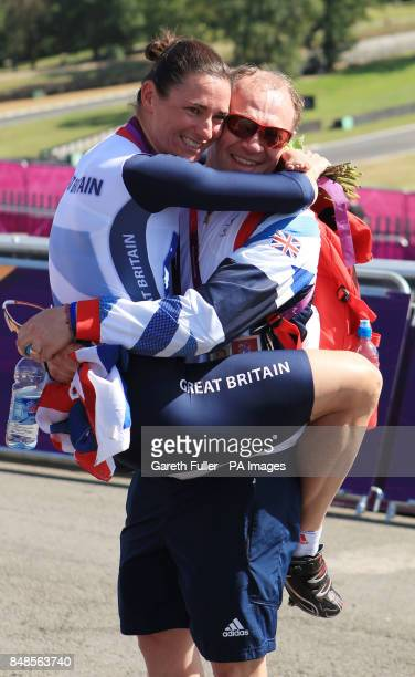 Great Britain's Sarah Storey celebrates with husband Barney following victory in the Women's Individual C5 Time Trial at Brands Hatch, Kent.