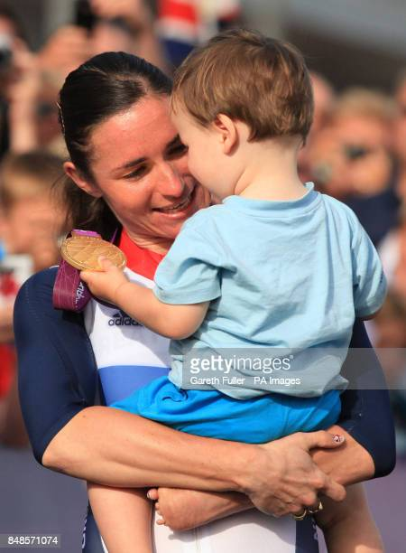 Great Britain's Sarah Storey shows her 2 year old nephew Gethin Crayford her gold medal after winning the Women's Individual C 4-5 Road Race at...