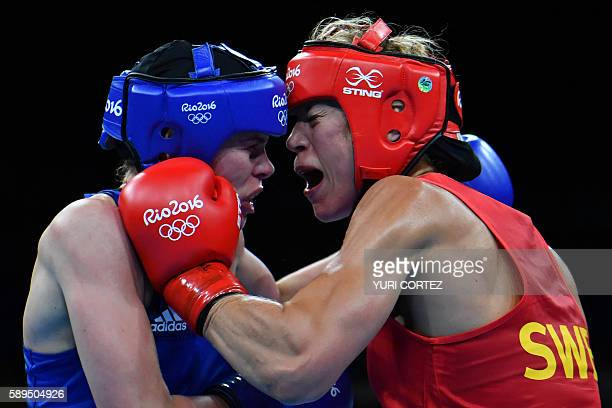 Great Britain's Savannah Marshall is punched by Sweden's Anna Laurell Nash during the Women's Middle match at the Rio 2016 Olympic Games at the...