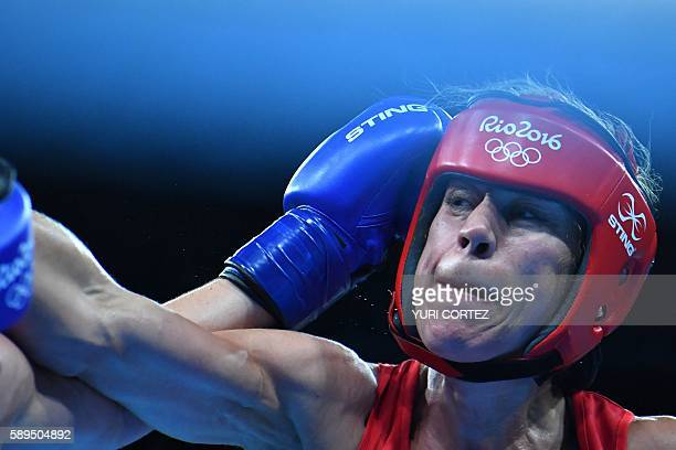 Great Britain's Savannah Marshall throws a punch at Sweden's Anna Laurell Nash during the Women's Middle match at the Rio 2016 Olympic Games at the...