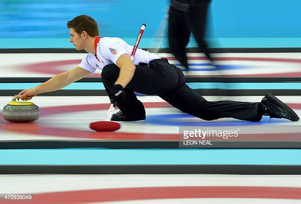 Great Britain's Scott Andrews throws the stone during the Men's Curling Gold Medal Game between Canada and Great Britain at the Ice Cube Curling...
