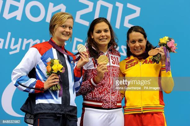 Great Britain's silver medallist Hannah Russell Russia's gold medallist Oxana Savchenko and Spain's bronze medallist Deborah Font celebrate with...