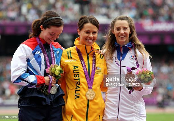 Great Britain's Stef Reid Australia's Kelly Cartwright and France's MarieAmelie le Fur receive their medals for the Women's Long Jump F42/44