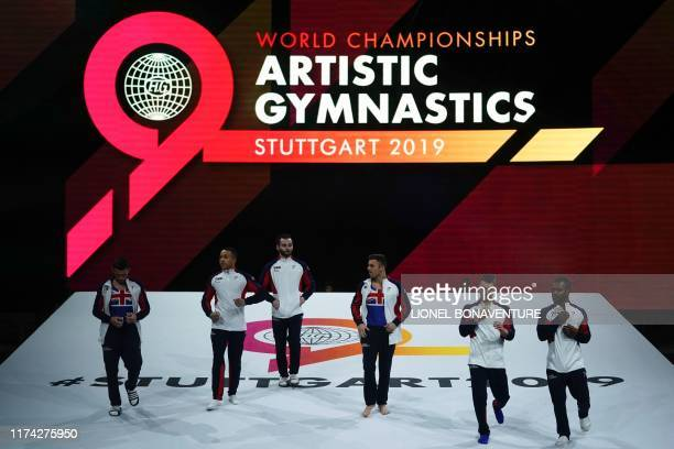 Great Britain's team arrives during the men's qualifying session at the FIG Artistic Gymnastics World Championships at the HannsMartinSchleyerHalle...