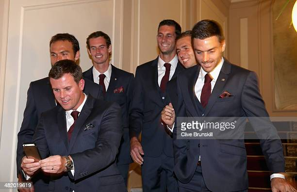 Great Britain's team captain Leon Smith checks his camera after taking a selfie of his team members Ross HutchinsAndy MurrayJames WardDan Evans and...