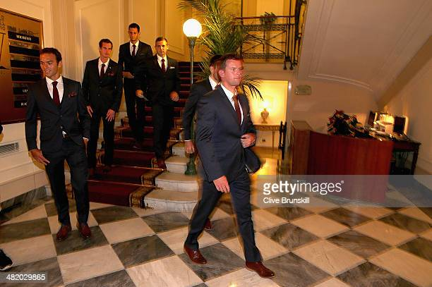 Great Britain's team captain Leon Smith leads his team members Ross HutchinsAndy MurrayJames WardDan Evans and Colin Fleming to the official dinner...