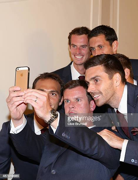 Great Britain's team captain Leon Smith takes a selfie of his team members Ross HutchinsAndy MurrayJames WardDan Evans and Colin Fleming after posing...