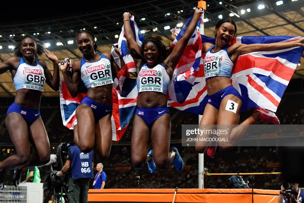Great Britain's team celebrate after the women's 4x100m relay final during the European Athletics Championships at the Olympic stadium in Berlin on August 12, 2018.