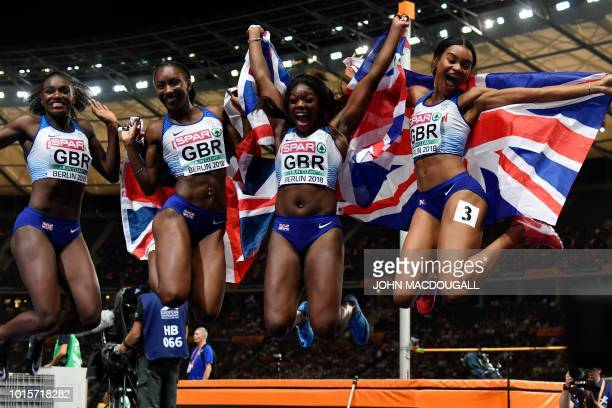 Great Britain's team celebrate after the women's 4x100m relay final during the European Athletics Championships at the Olympic stadium in Berlin on...