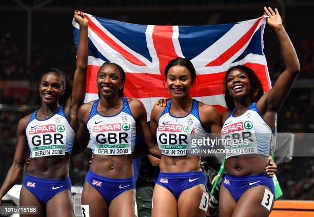 Great Britain's team celebrates after the women's 4x100m relay final during the European Athletics Championships at the Olympic stadium in Berlin on...