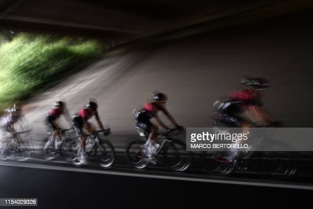 Great Britain's Team Ineos cycling team passes under a bridge in the first stage of the 106th edition of the Tour de France cycling race between...