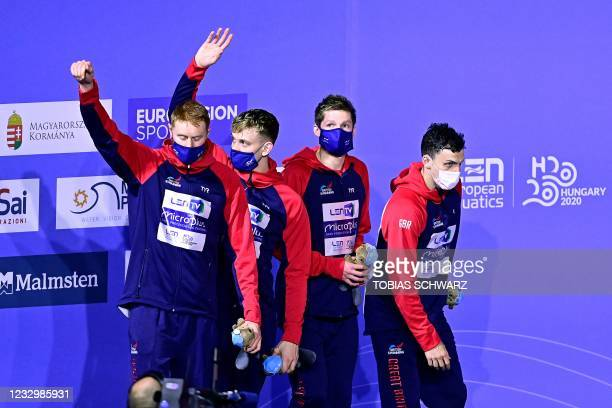 Great Britain's team members celebrate their silver medal on the podium of the Mens 4x200m Freestyle Relay Swimming event during the LEN European...