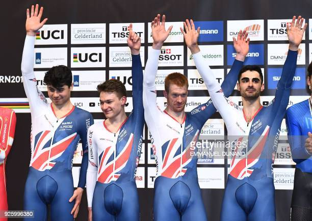 Great Britain's team members Charlie Tanfield Ethan Hayter Edward Clancy and Kian Emadi pose on the podium after winning the men's Team Pursuit...
