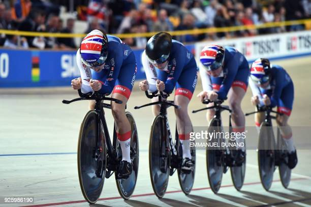 Great Britain's team members Katie Archibald Laura Kenny Emiliy Nelson and Elinor Barker compete in the women's pursuit final during the UCI Track...