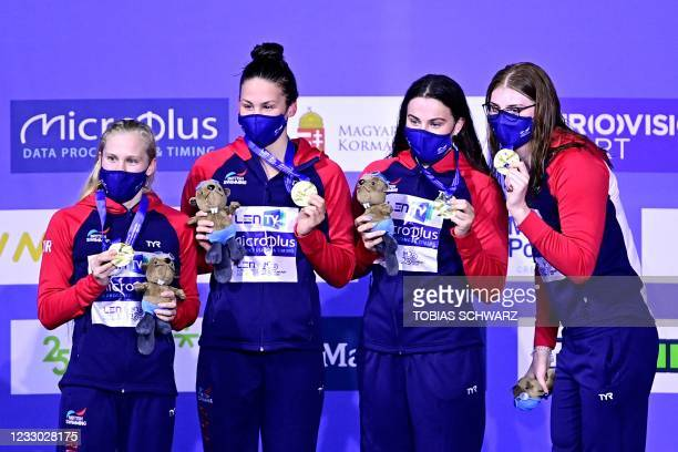Great britain's team members pose their gold medals on the podium of the Womens 4x200m Freestyle Relay Swimming event during the LEN European...