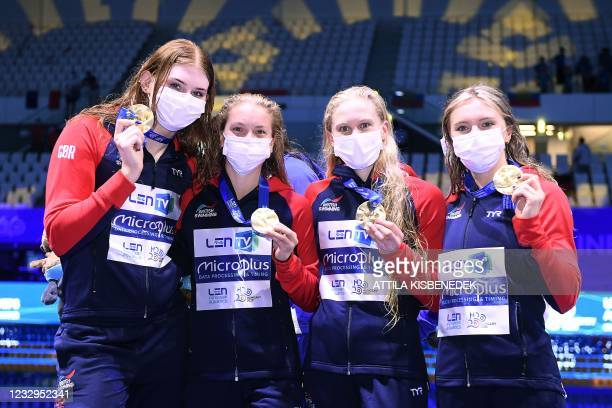 Great Britain's team members pose with their gold medals on the podium of the Womens 4x100m Freestyle Relay Swimming event during the LEN European...