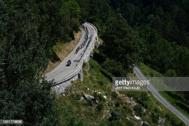 Great Britain's Team Sky cycling team riders lead the pack's ascent up the Col de la Madeleine pass during the twelfth stage of the 105th edition of...