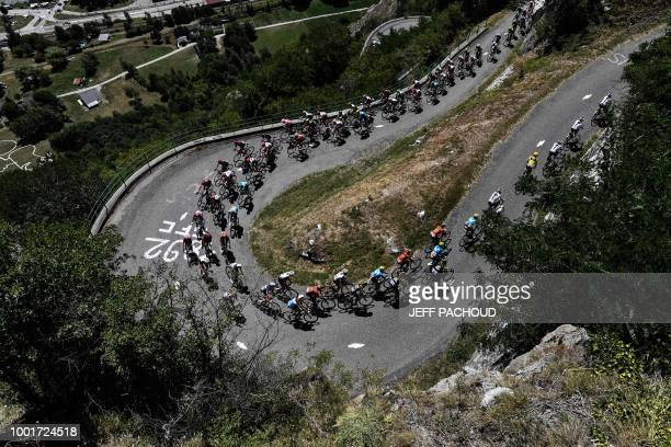 TOPSHOT Great Britain's Team Sky cycling team riders leads the ascent of the Montvernier bends during the twelfth stage of the 105th edition of the...