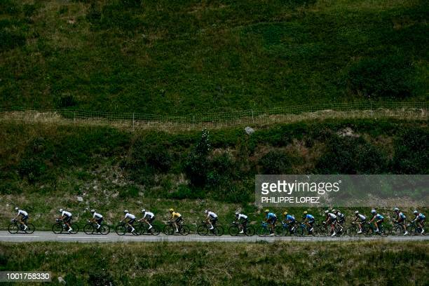 TOPSHOT Great Britain's Team Sky cycling team riders with Great Britain's Geraint Thomas wearing the overall leader's yellow jersey followed by Great...