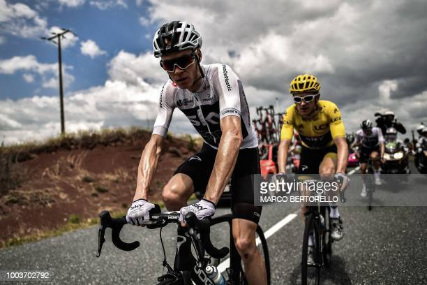TOPSHOT Great Britain's Team Sky cycling team teammates Great Britain's Christopher Froome and Great Britain's Geraint Thomas wearing the overall...