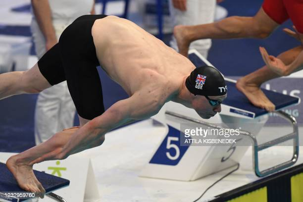 Great Britain's Thomas Dean dives to competes in a heat for the Mens 100m Freestyle Swimming event during the LEN European Aquatics Championships at...