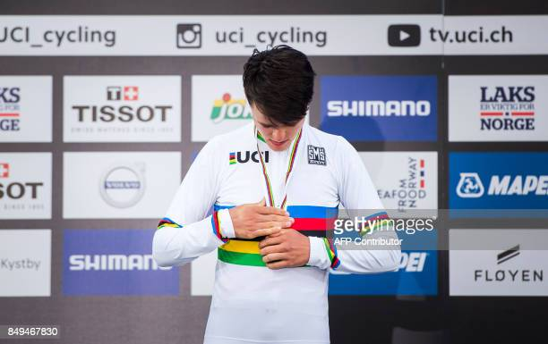 Great Britain's Thomas Pidcock reacts with his gold medal after winning the men's junior individual time trial at the UCI Cycling Road World...