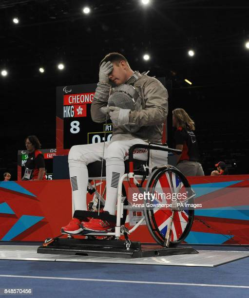Great Britain's Tom Hall Butcher loses to Hong Kong's Meng Chai Cheong in the Men's Individual Sabre event at the ExCel Arena London